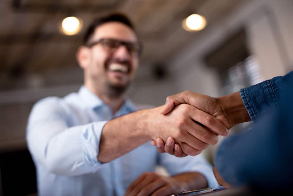 business agreements between two men in an SEO project - White Crow Marketing